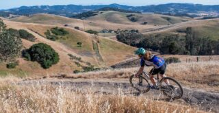 Young woman riding a Marin Team Marin 1 mountain bike, Sonoma County CA.