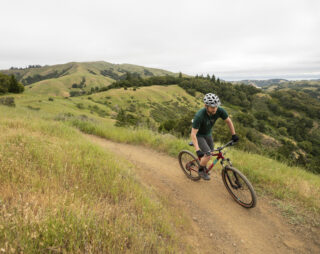 image of rider Ian climbing a hill on a Bobcat Trail 4