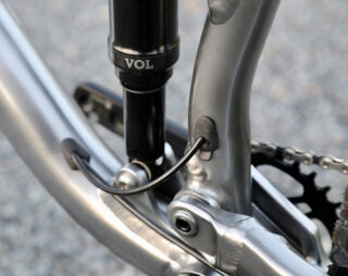 Detail image of the Rift Zone 27.5 dropper post routing from the downtube to the seattube