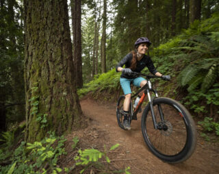 Rider Stacey on a trail on a Marin Wildcat Trail bike, Marin County CA.
