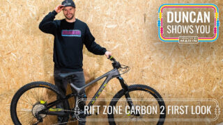 Bike rider Duncan Shaw stands with his Rift Zone bike