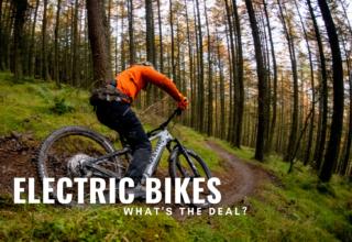 Man rides electric bike through forest
