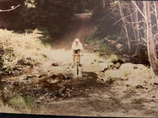 Old photo of kid riding a mountain bike on Mt. Tam, Marin County.