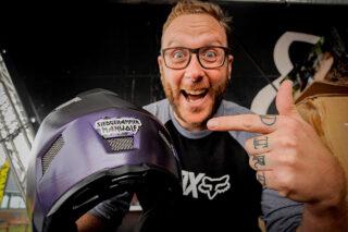 John Oldale pointing at his helmet