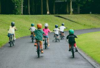 Kids riding Donky Jr kids bikes on a path, Japan.