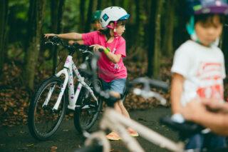 Girl pushing a Marin Donky Jr bike, Japan.