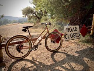 Marin Larkspur 2 bike leaning up a road closed gate, Occidental CA