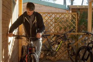 Marin's Matt Cipes, adjusting a mountain bike, Italy.