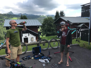 Marin's Chris Holmes and Matt Cipes, pondering bike repairs in a Les Gets, France parking lot.