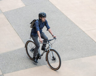 Man riding bike in city from above