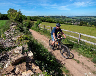 Father and son ride mountain bike with Kids Ride Shotgun Childs Bike Seat