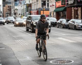 Man riding in city on drop bar bike