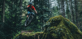 Mark Matthews launching off a ramp, deep in the woods of British Columbia.