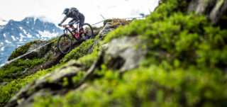 Martha Gill racing an Enduro World Series event, in the mountains of Europe.