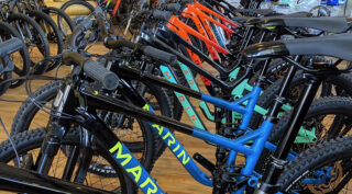 Marin bikes lined up in a bike shop.