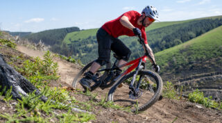 Rider Nikki Whiles riding a Rift Zone 29 on a mountain trail, Wales UK.