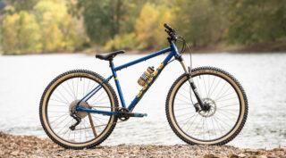 Marin Pine Mountain 1 mountain bike, propped up next to a river.