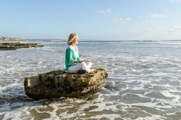 Woman Meditating At The Ocean