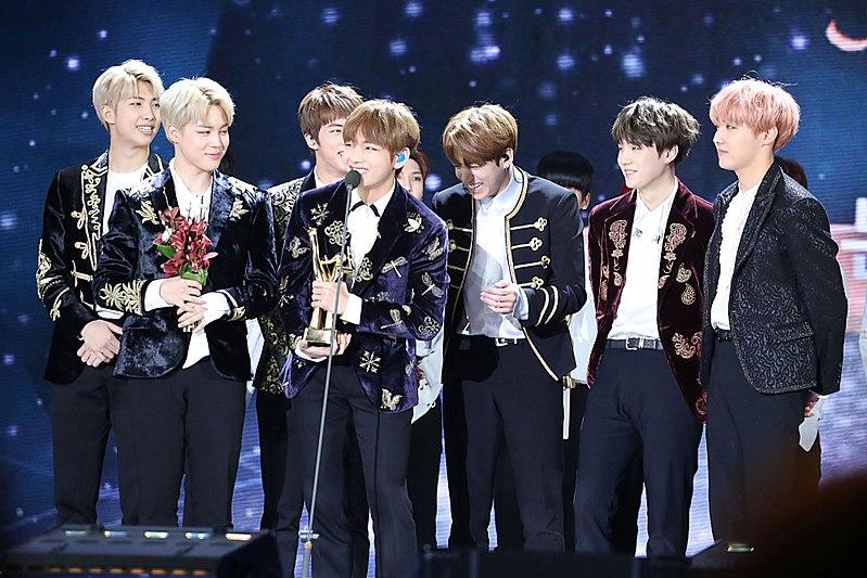 BTS kpop group accepting award.