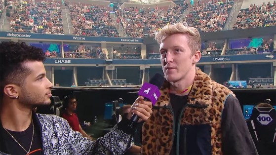 An image of Tfue taking part in an interview during a Fortnite tournament.