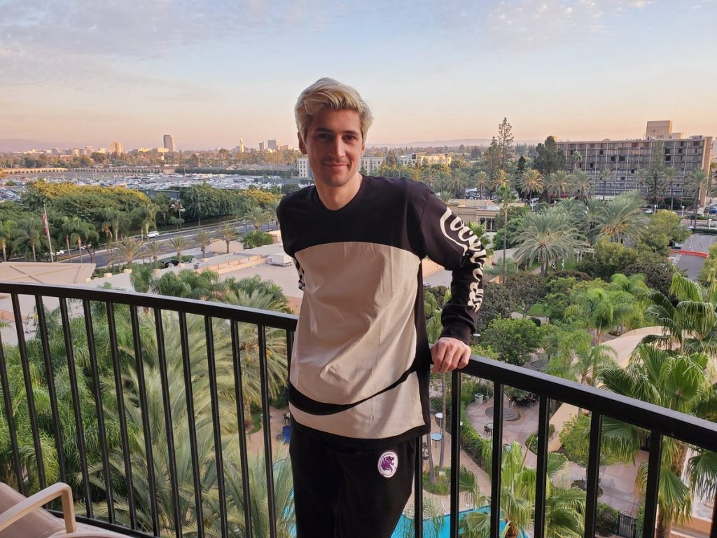 xQc posing on a balcony.