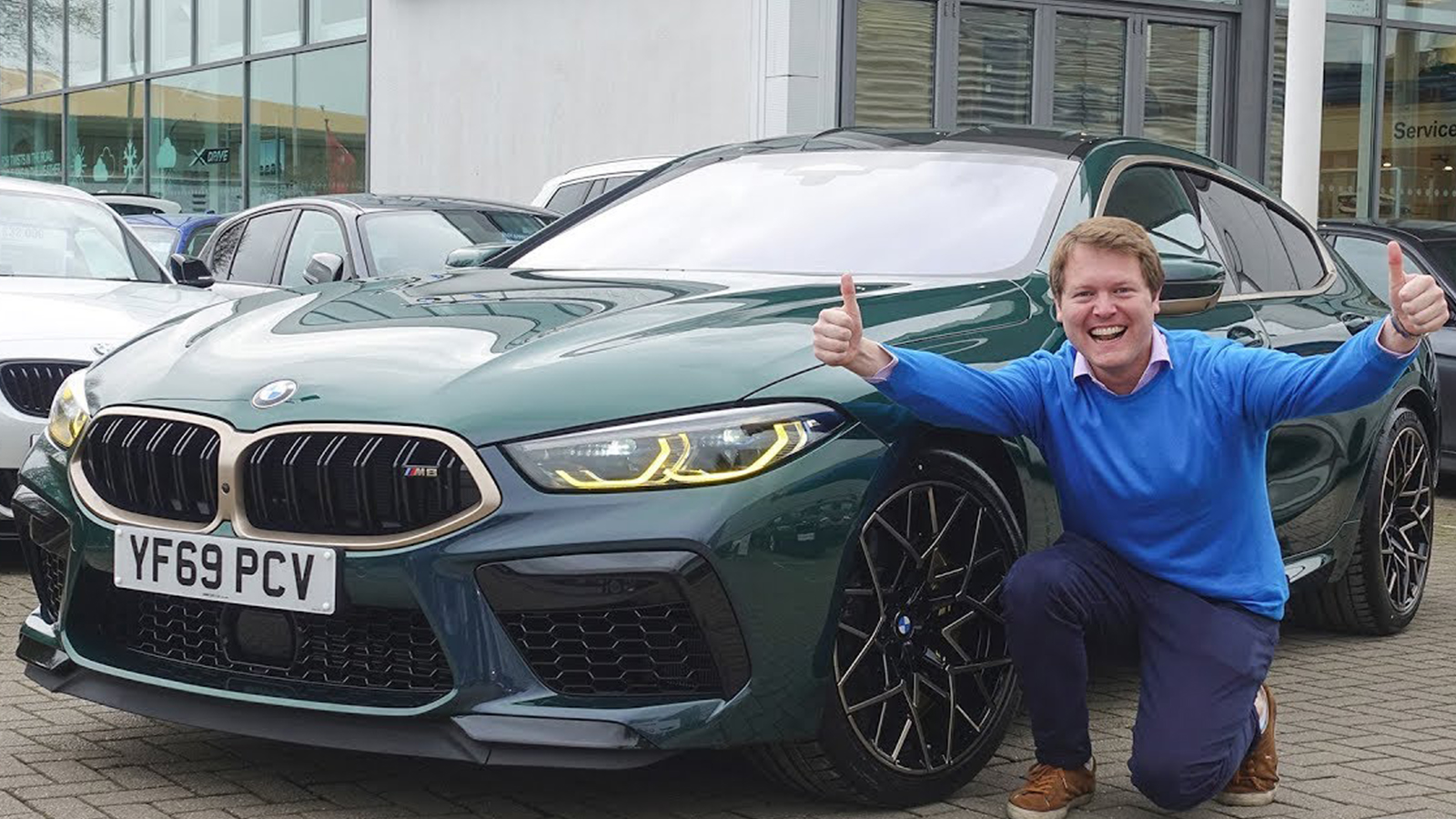 Image of Shmee150 with his green BMW M8