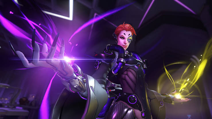 Overwatch support hero Moira demonstrating her mix of healing and damaging abilities.