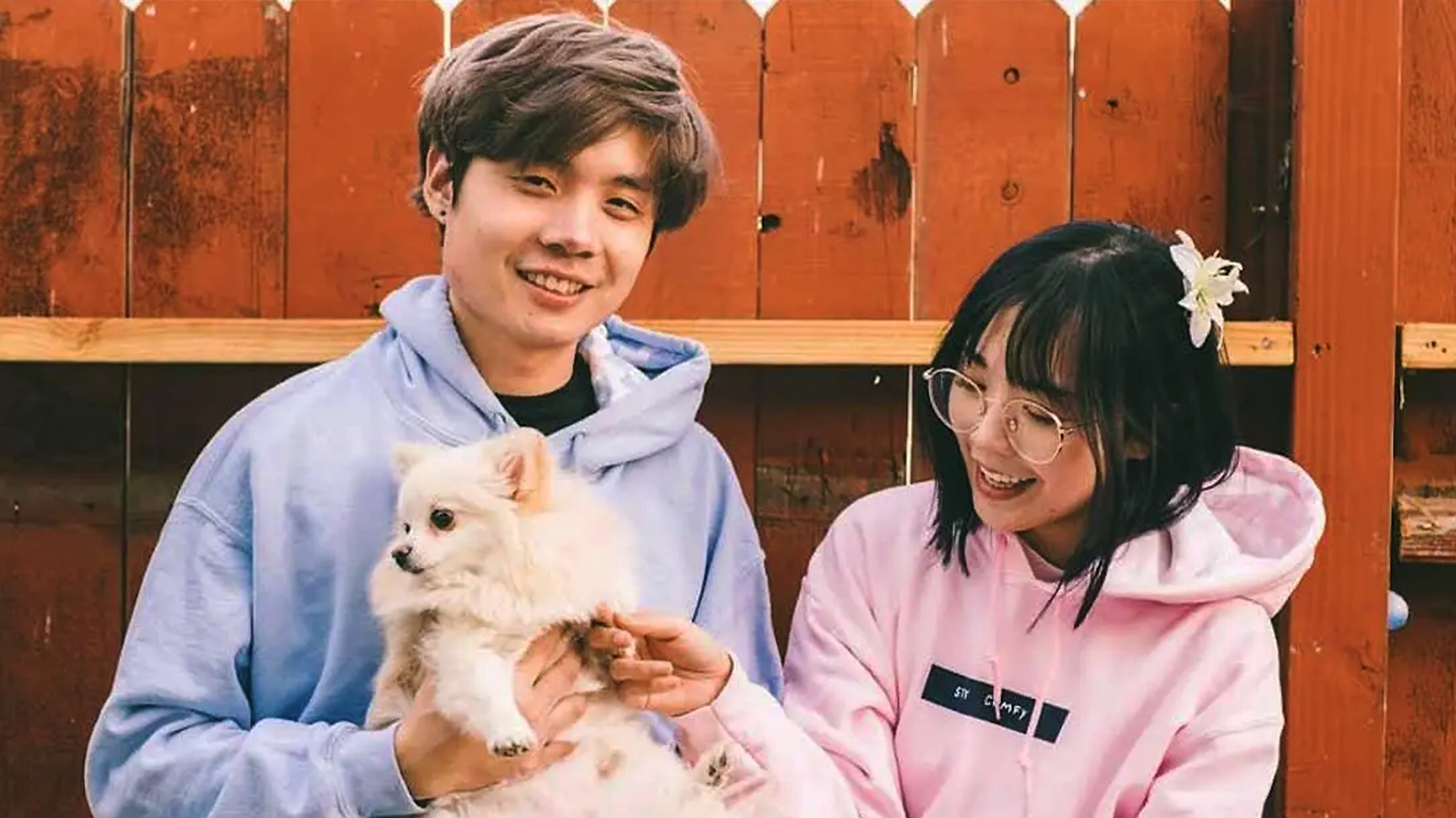 Sleightlymusical and LilyPichu holding dog together