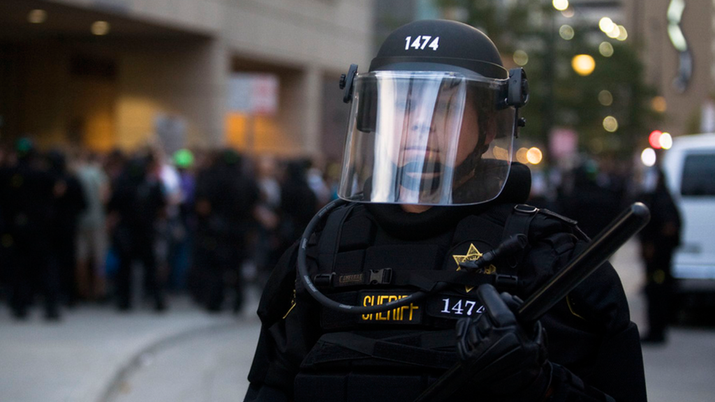 Police officer in riot gear