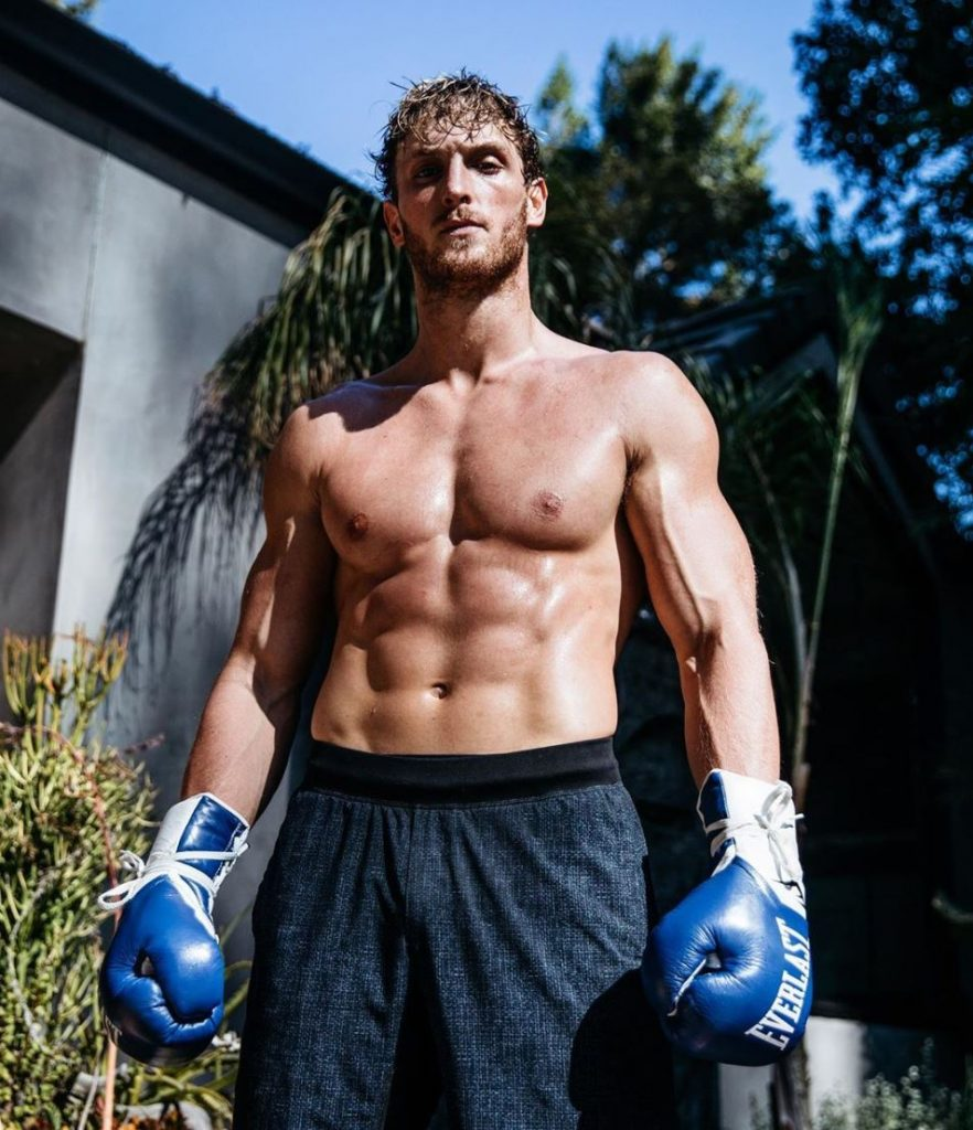 Logan Paul poses in boxing gloves.