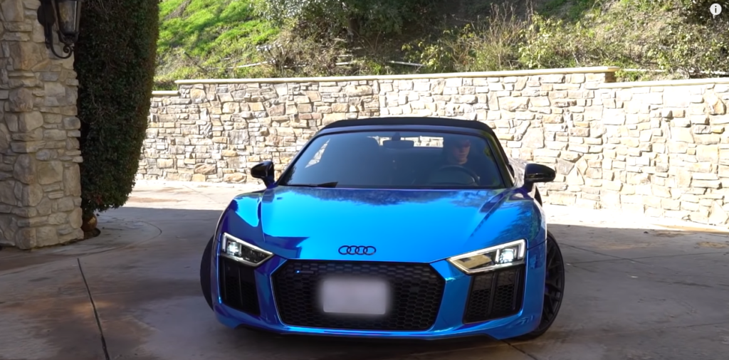 Jesser driving his Audi R8 Spyder into his house.