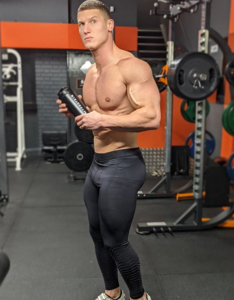 MattDoesFitness poses for a photo in the gym.