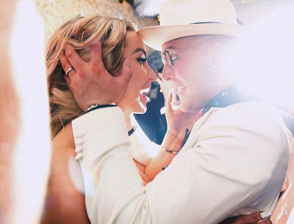 Tana Mongeau embraces her hubby Jake Paul on their wedding day.