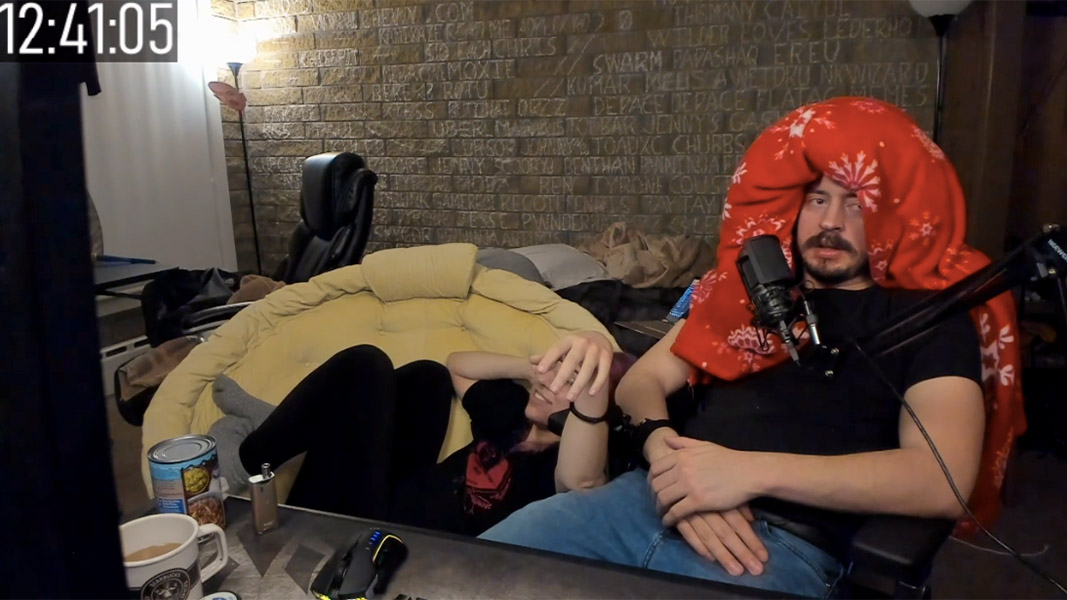 An image of two people handcuffed together during a livestream.