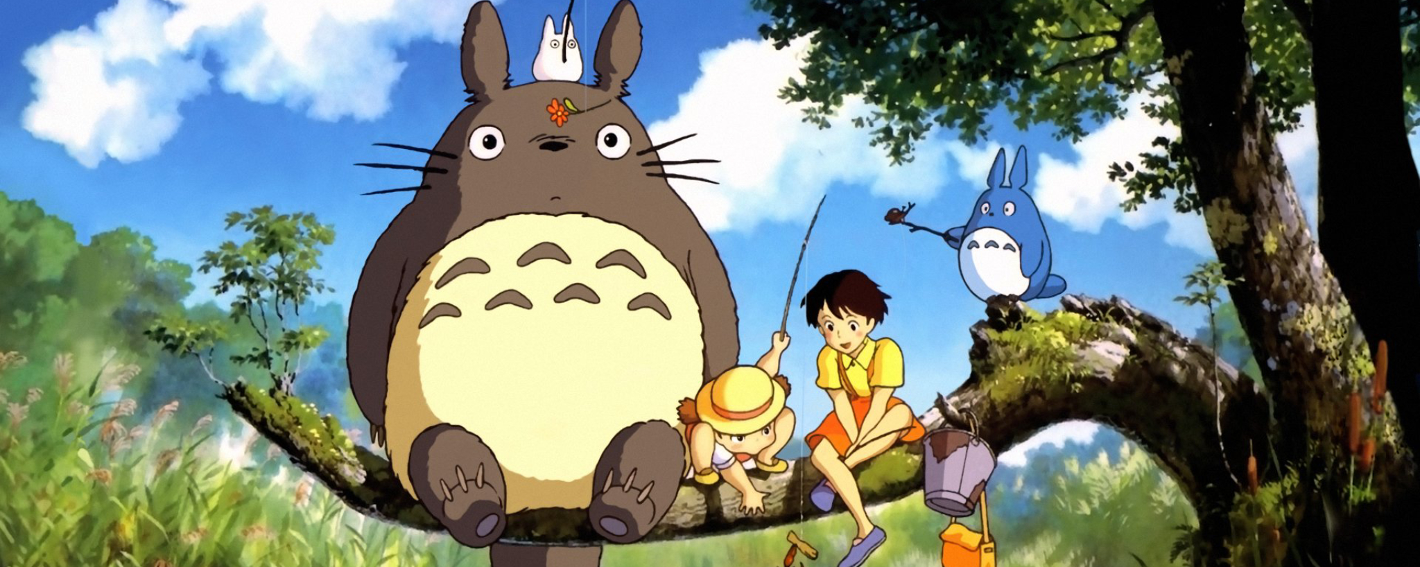 Totoro sitting on a tree branch