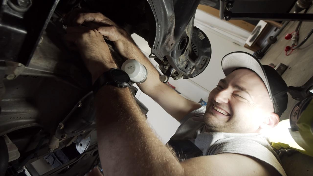 Martin underneath a Toyota Yaris