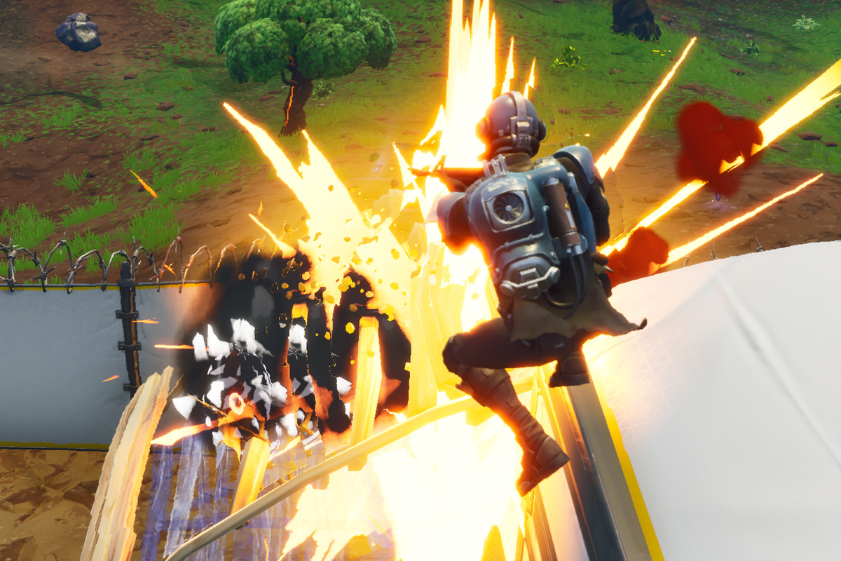 Players jumping away from explosions.
