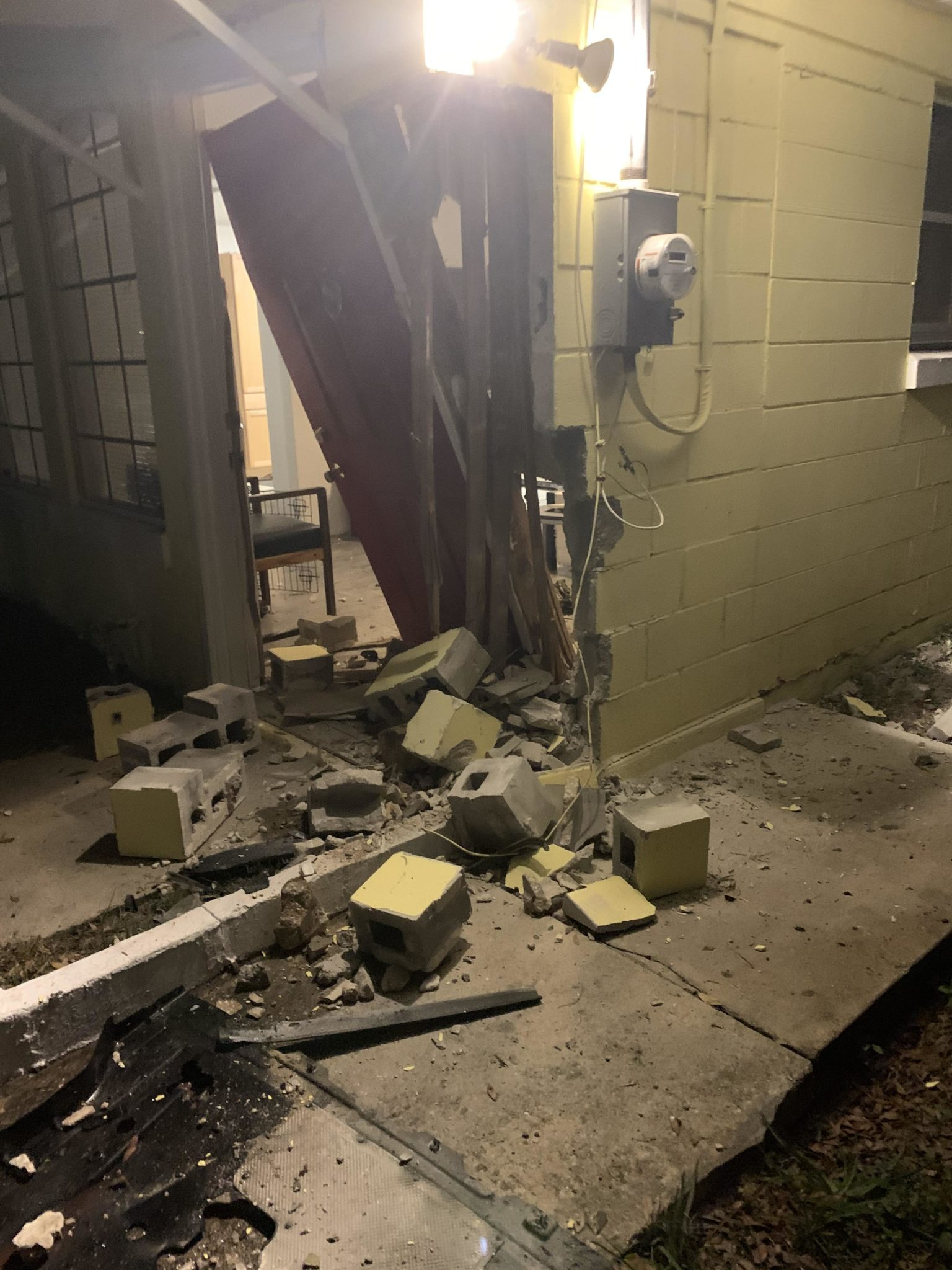 Broken wall of house with bricks on the ground after a car hit CSGO streamer's house