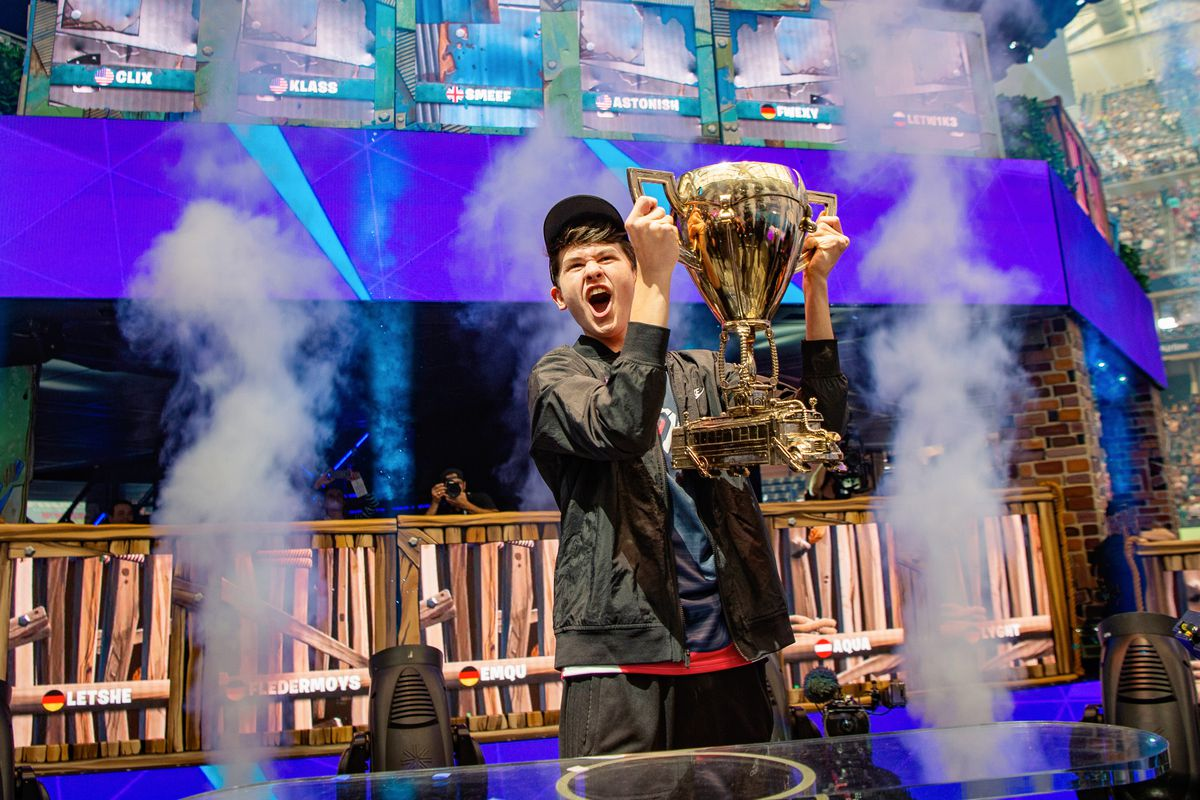 Bugha lifting trophy at Fortnite World Cup 2019