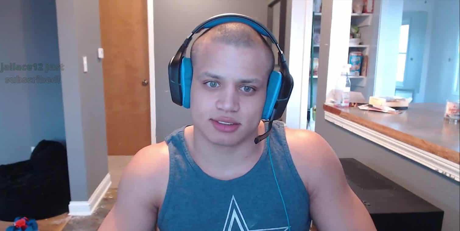 Tyler1 wearing headset on Twitch stream.