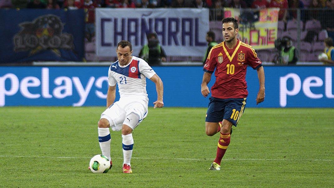 An image of Marcelo Diaz playing footbal for Chile alongside Cesc Fabregas