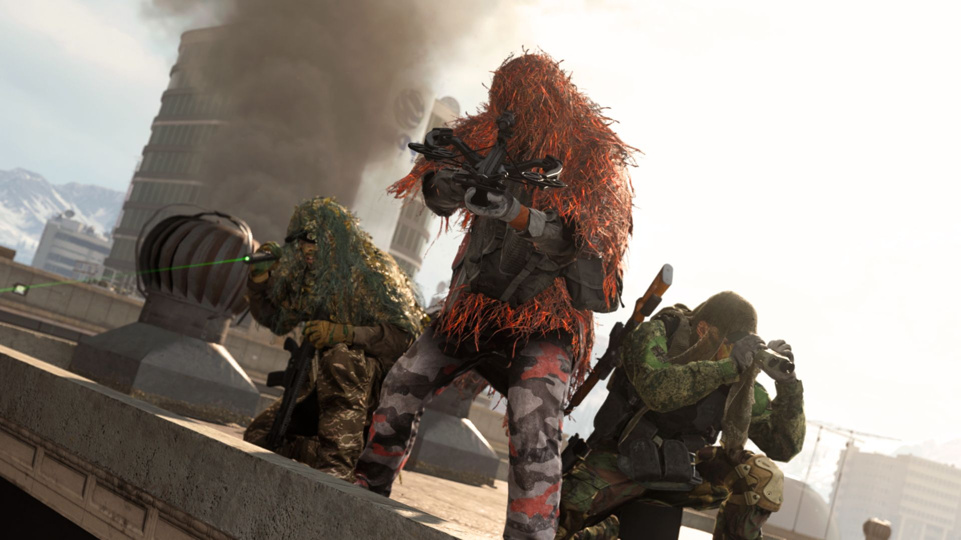Warzone players sniping from a rooftop.