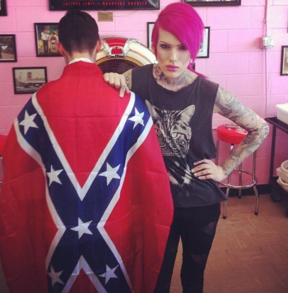 Jeffree Star poses next to fan wearing Confederate Flag