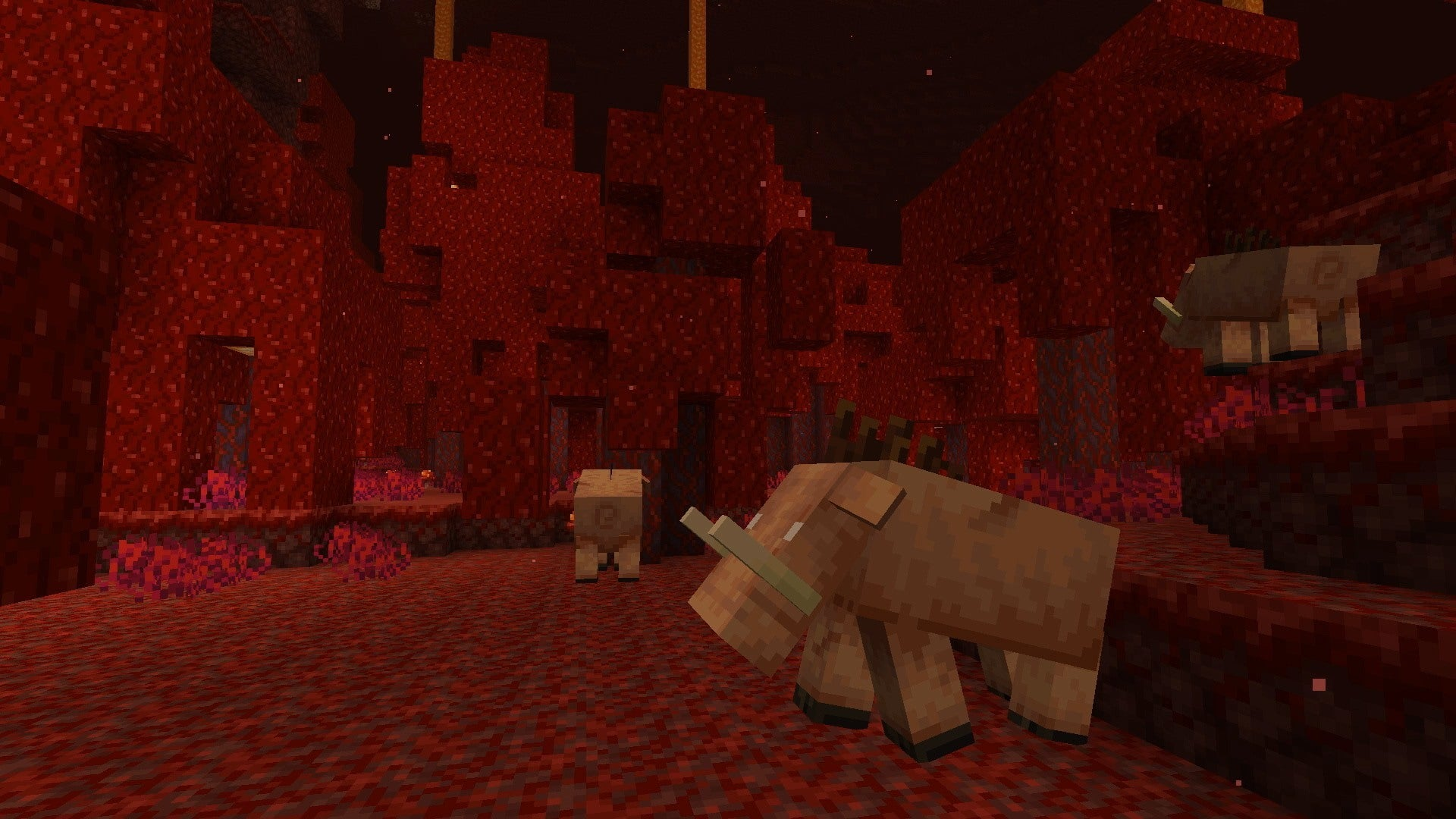 Two Minecraft Hoglin in the Nether.