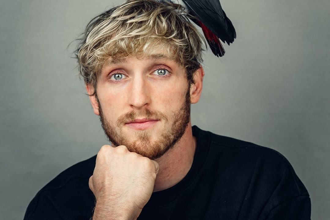 Logan Paul with parrot on head