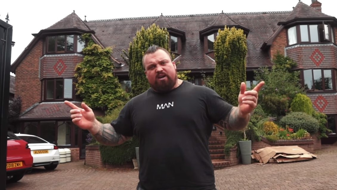 Eddie Hall standing outside his house.