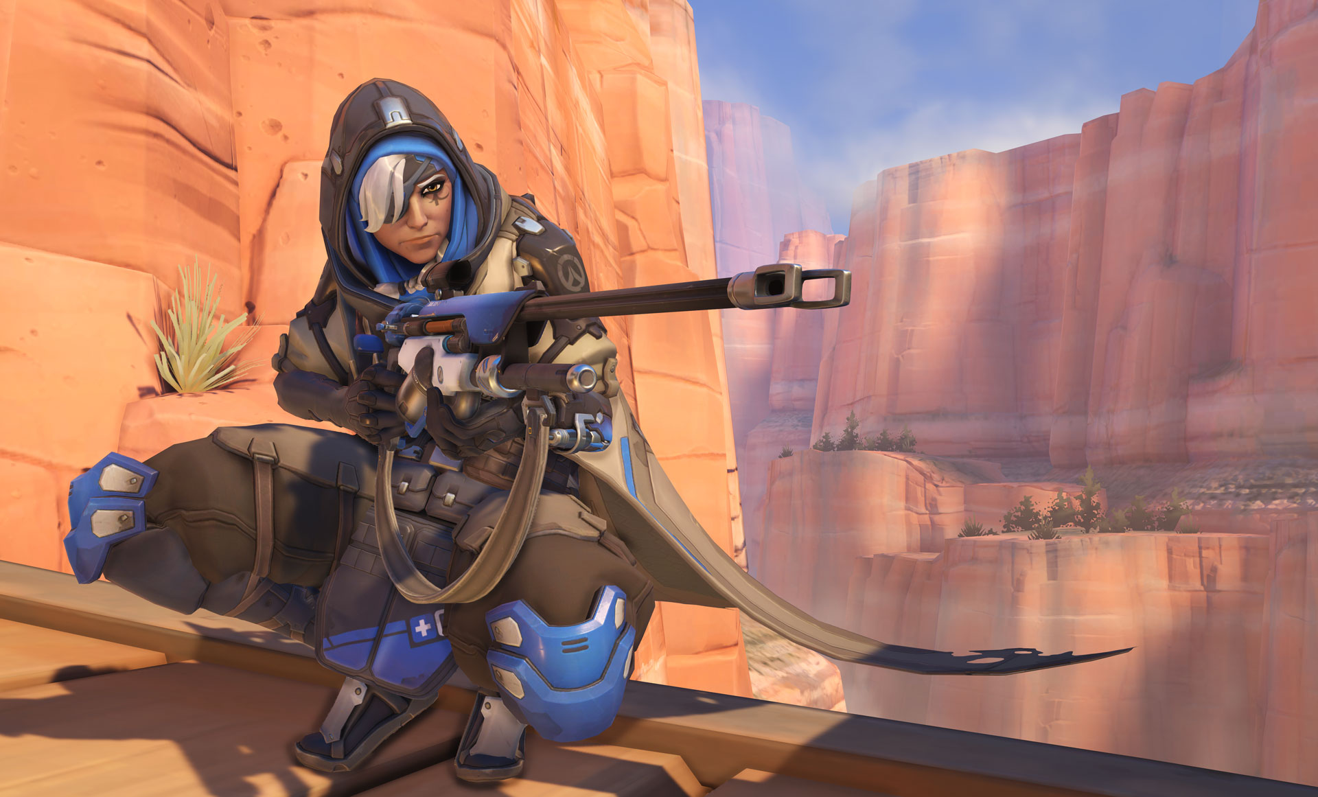 Ana crouching on Route 66 in Overwatch