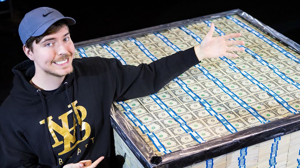 Mr Beast in front of crate of money