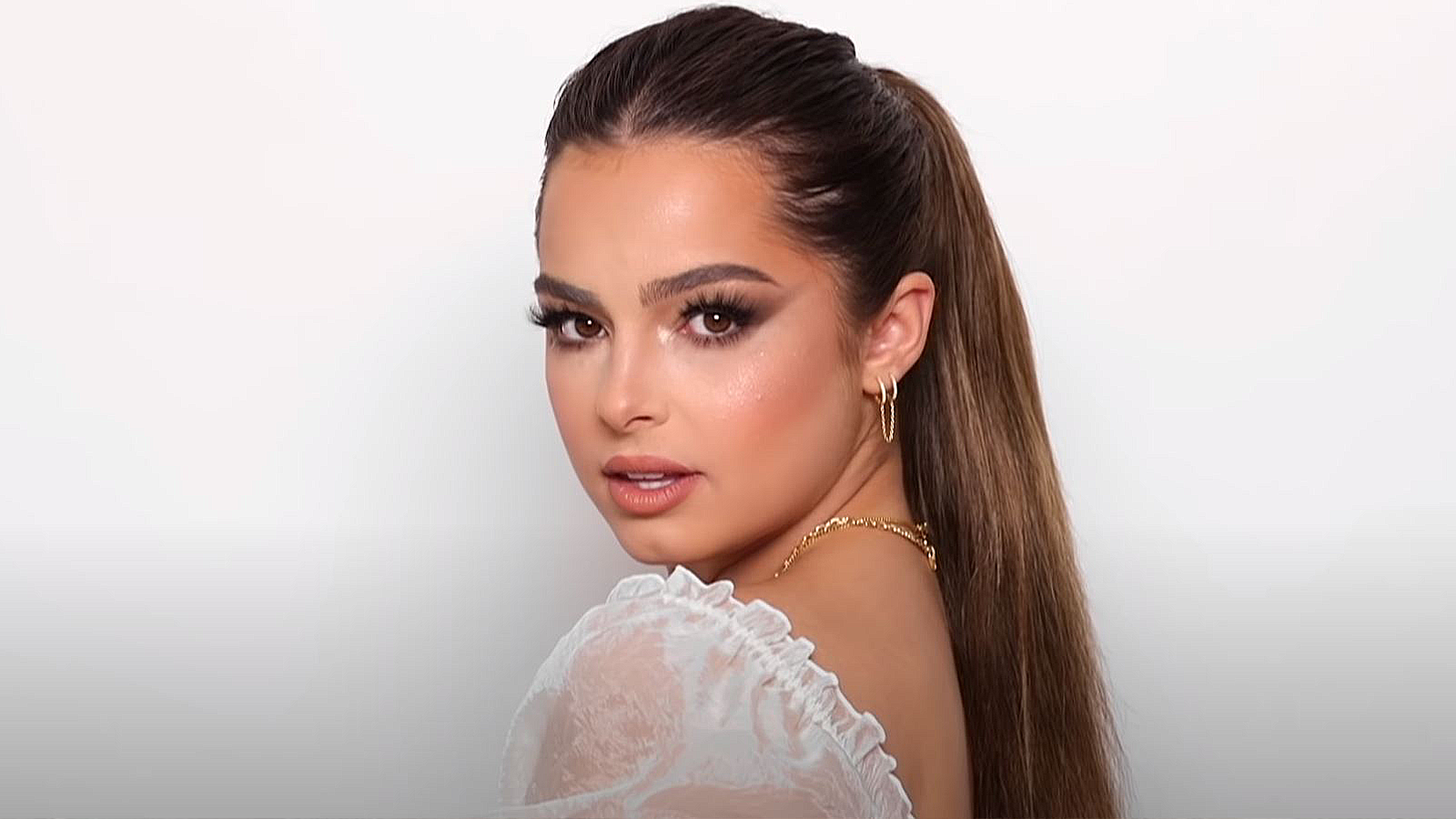 Addison Rae poses in makeup done by James Charles