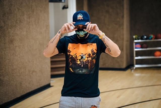Rapper Logic wearing mask